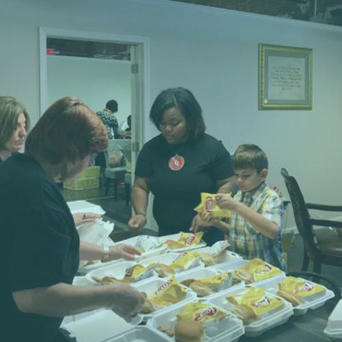 Serve team preparing lunch plates